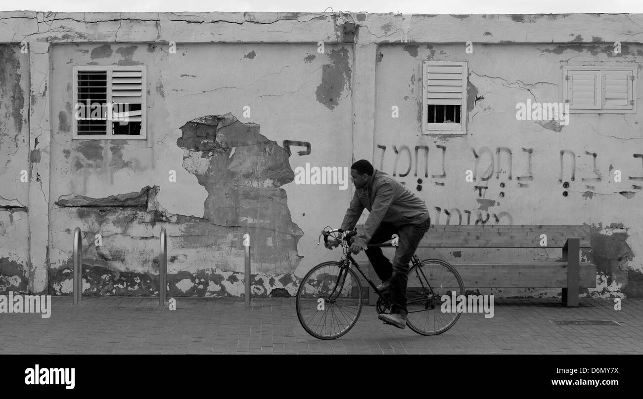Person in Tel Aviv on a bicycle - Stock Image