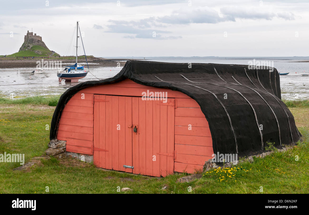 Great Britain, Holy Island, Overturned Boat Hull Used As Storage Shed,  Lindisfarne Castle In Distance