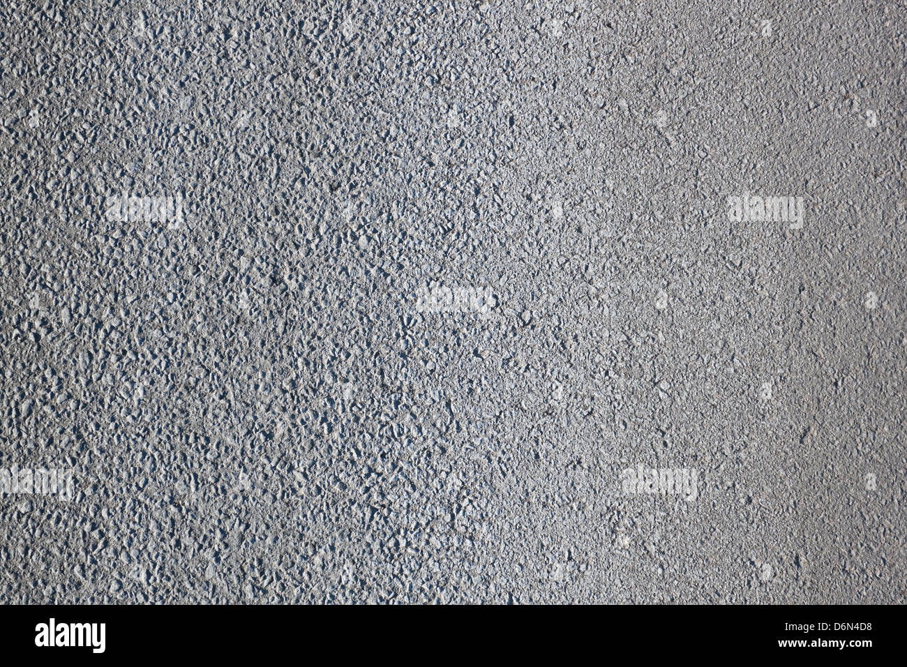Pattern of the grainy asphalt surface - Stock Image