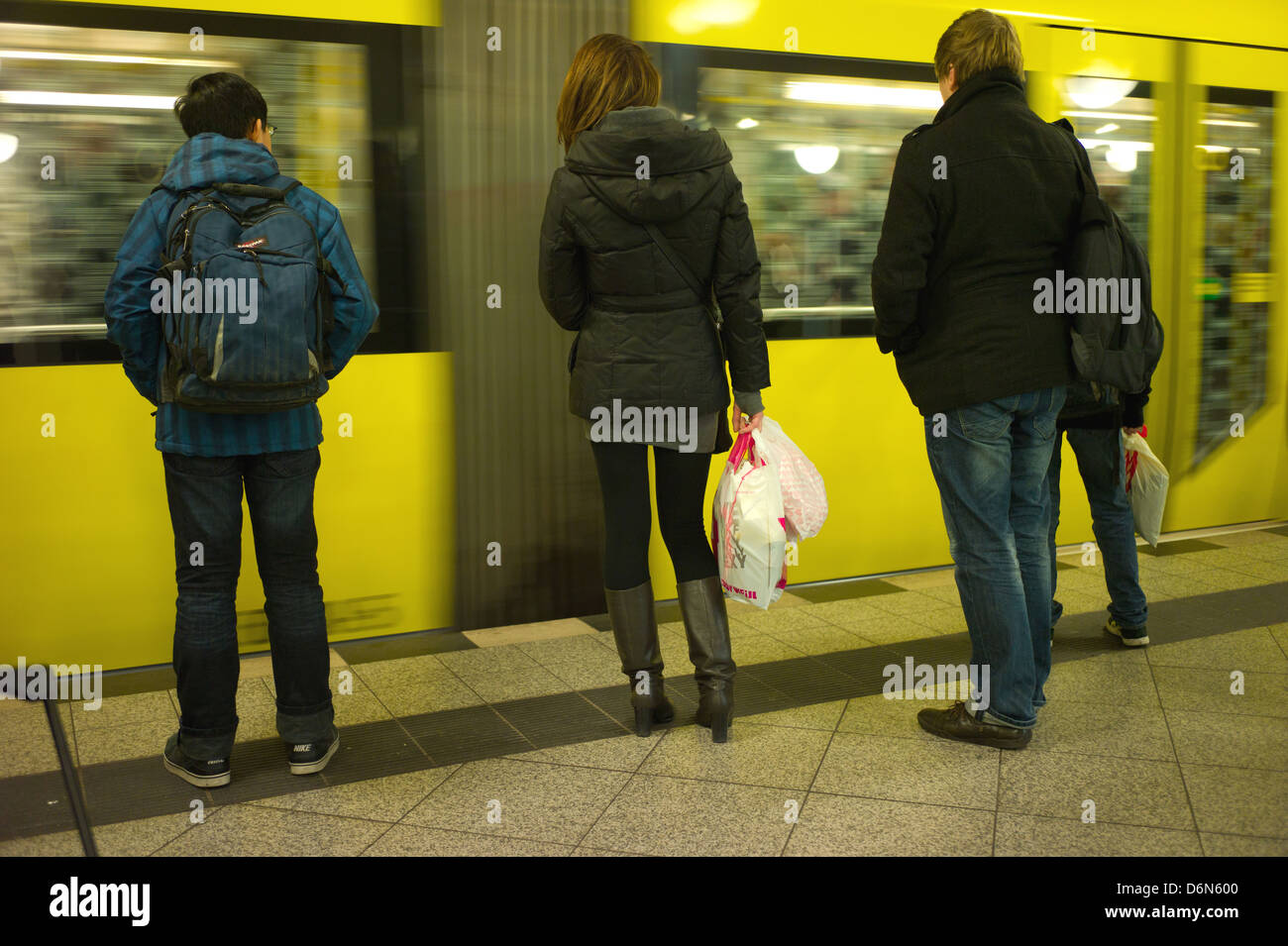 Berlin, Germany, Passengers on the platform of the incoming U2 at Alexanderplatz - Stock Image