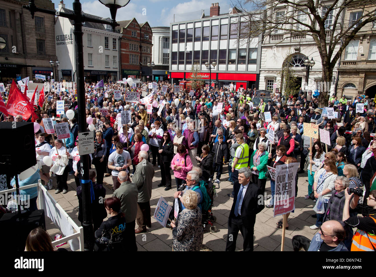 Protesters march through Stafford against cuts to NHS services at Stafford Hospital - Stock Image