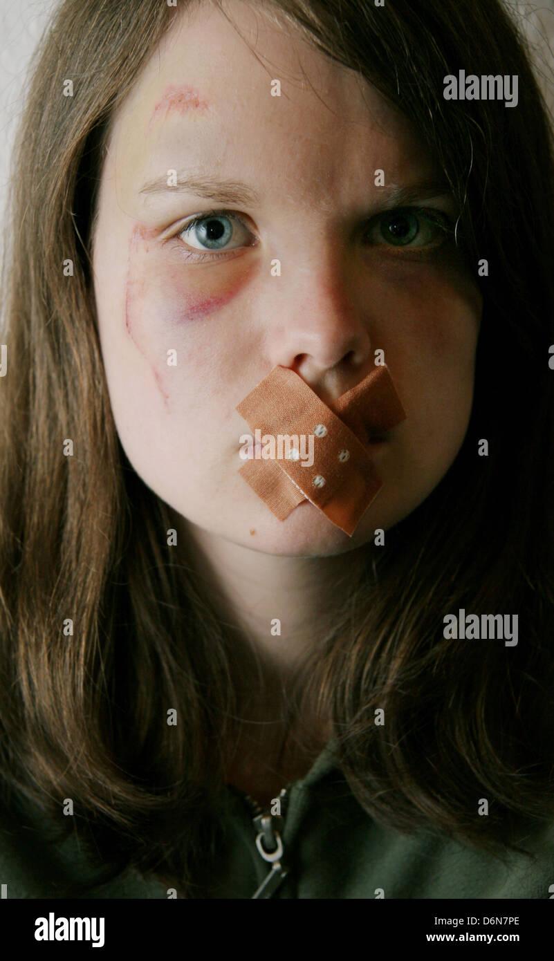 teenager,fear,adhesive bandage,violence,mute Stock Photo