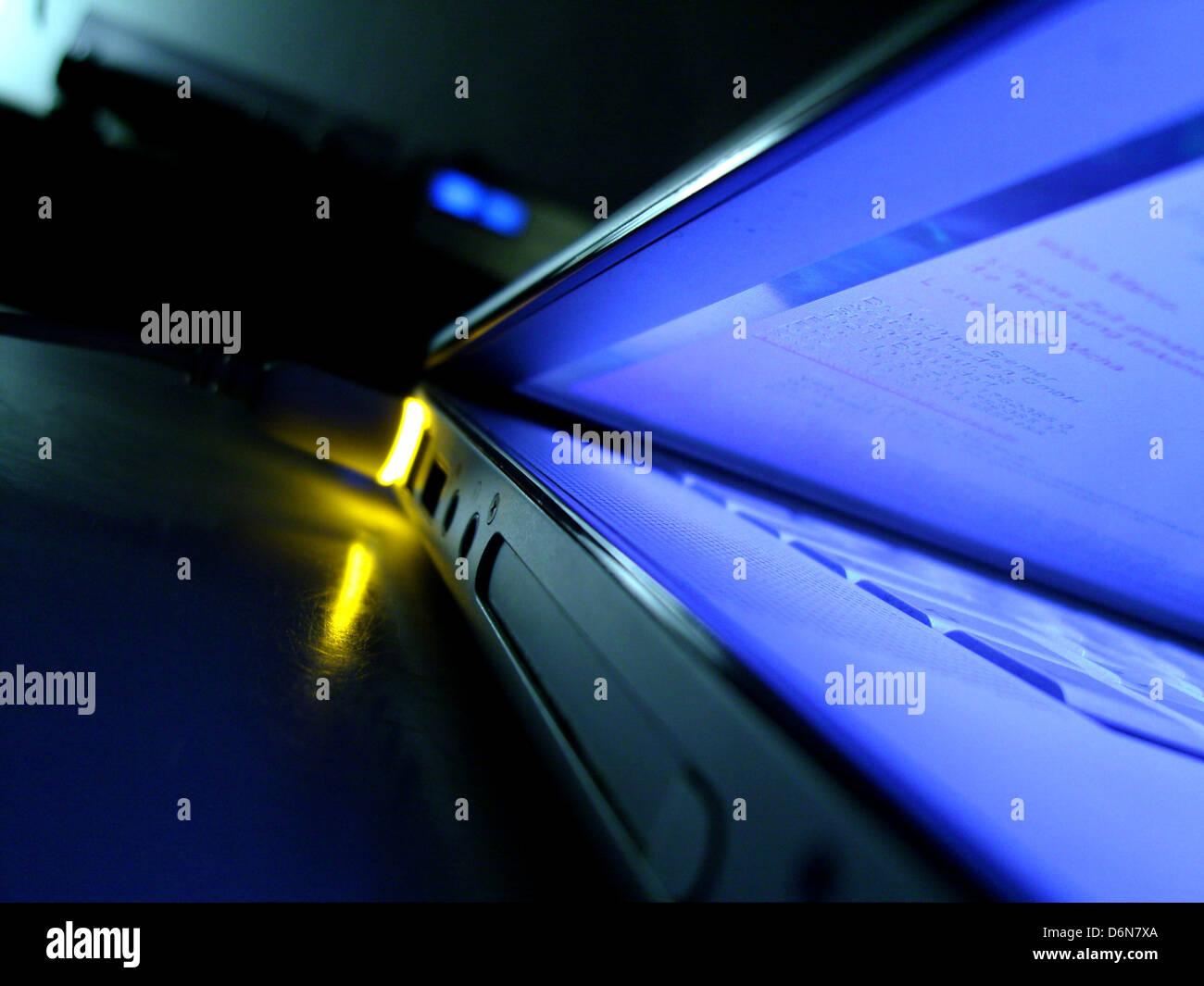 palmtop,power cord - Stock Image