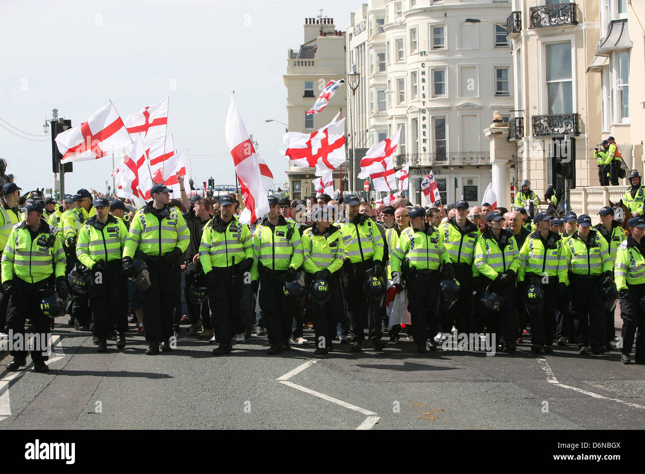 London, UK. 21st April, 2013.  EDL supporters take part in a 'March for England' in Brighton opposed by - Stock Image