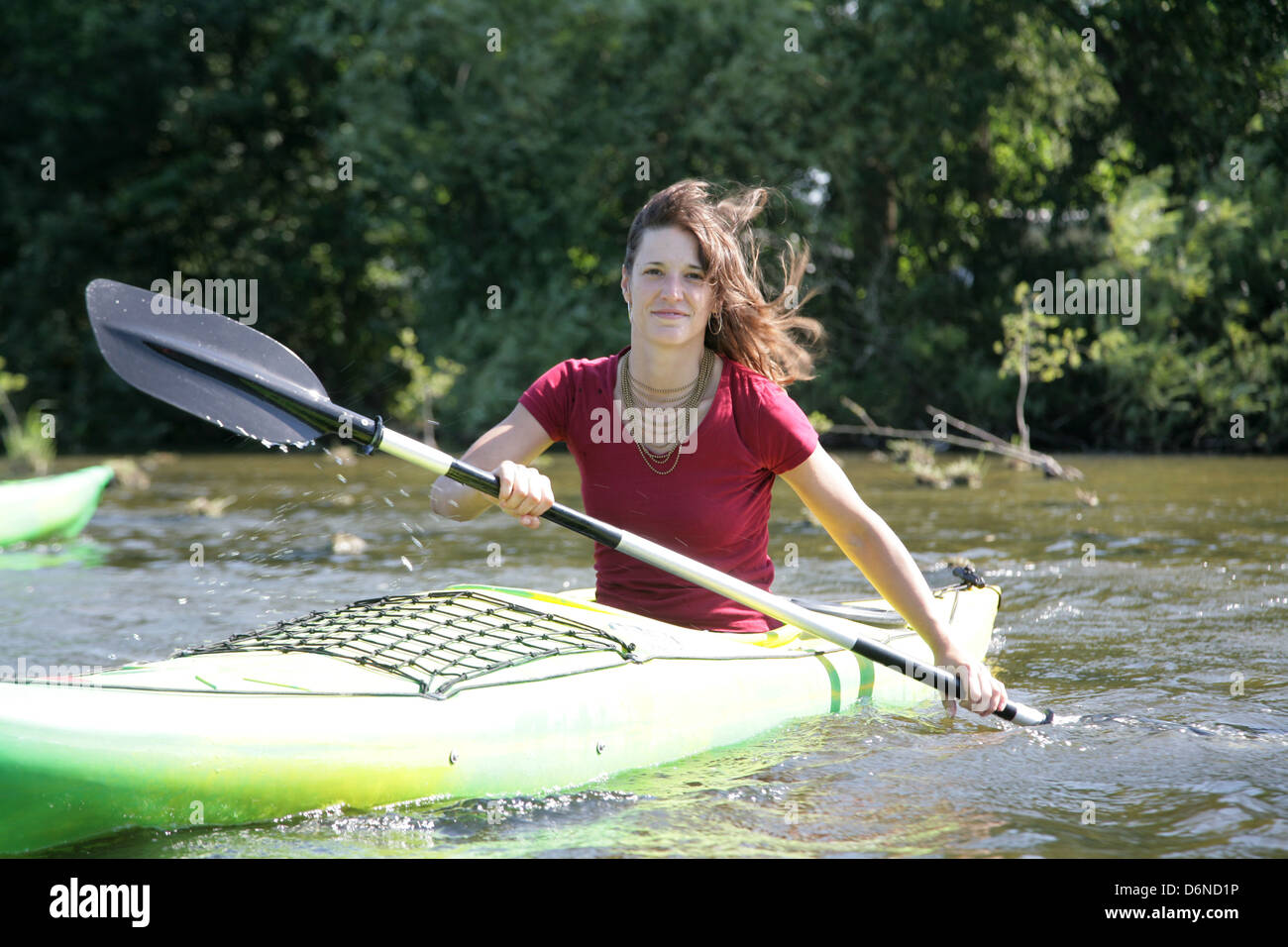 Ploen, Germany, a young woman makes a canoe trip on the Great lake Ploener - Stock Image