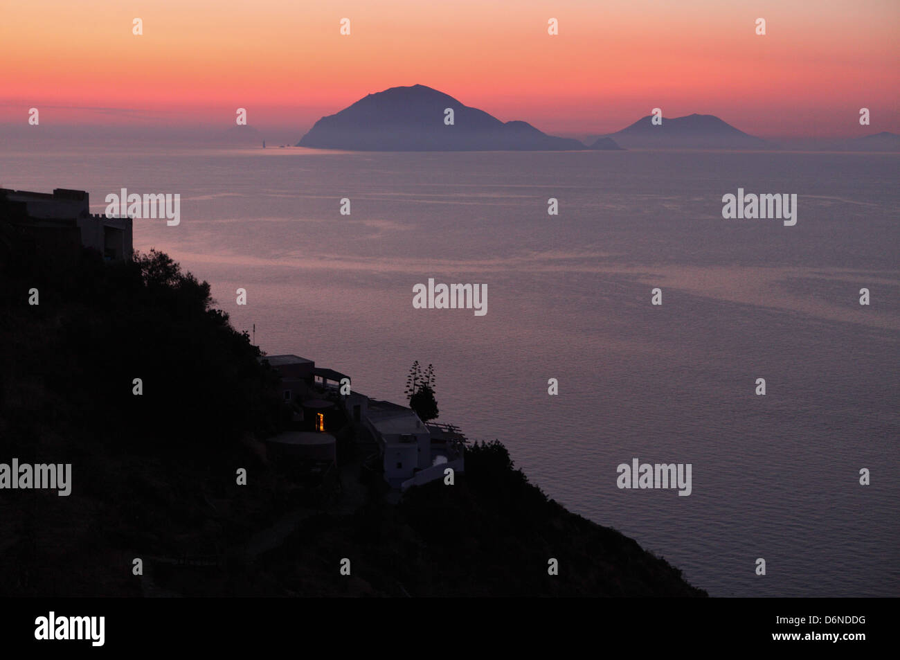 Alicudi, Italy, overlooking the islands Filicudi (left) and Salina at dusk Stock Photo