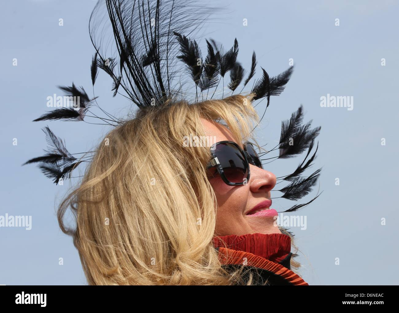 Fashion designer Nanna Kuckuck shows her new hat prior to the first horserace of the season in the racecourse Hoppegarten - Stock Image