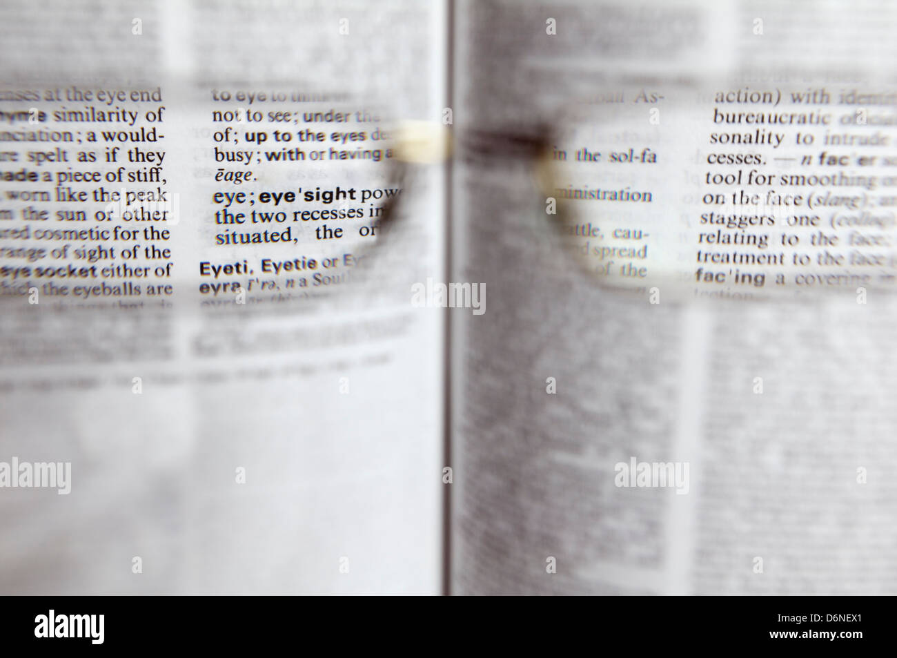 View through prescription glasses focusing on the word eyesight - Stock Image