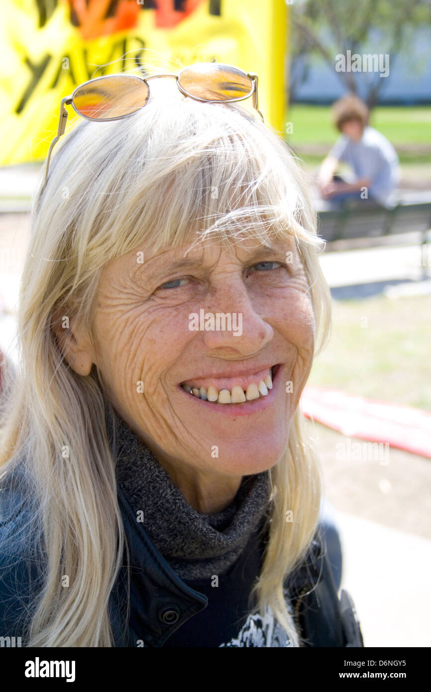 Blond haired happy mature woman with protruding teeth smiling. MayDay Parade and Festival Minneapolis Minnesota - Stock Image