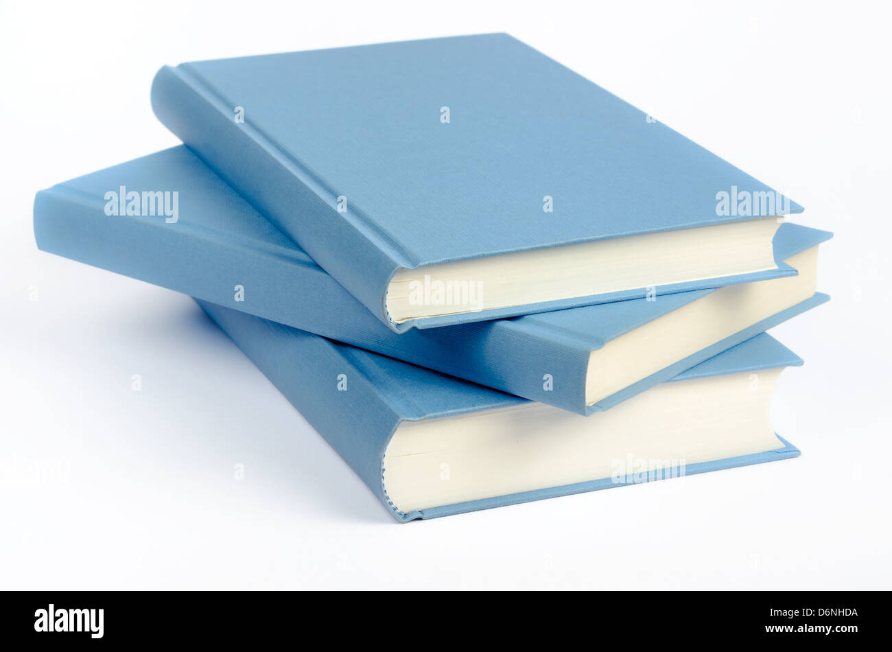 Three blue books on a white background - Stock Image