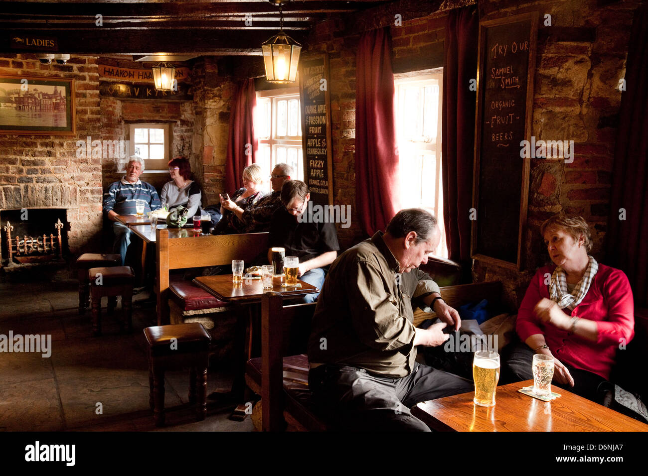 People sitting drinking in the interior of the Kings Arms Pub, York, Yorkshire, UK - Stock Image