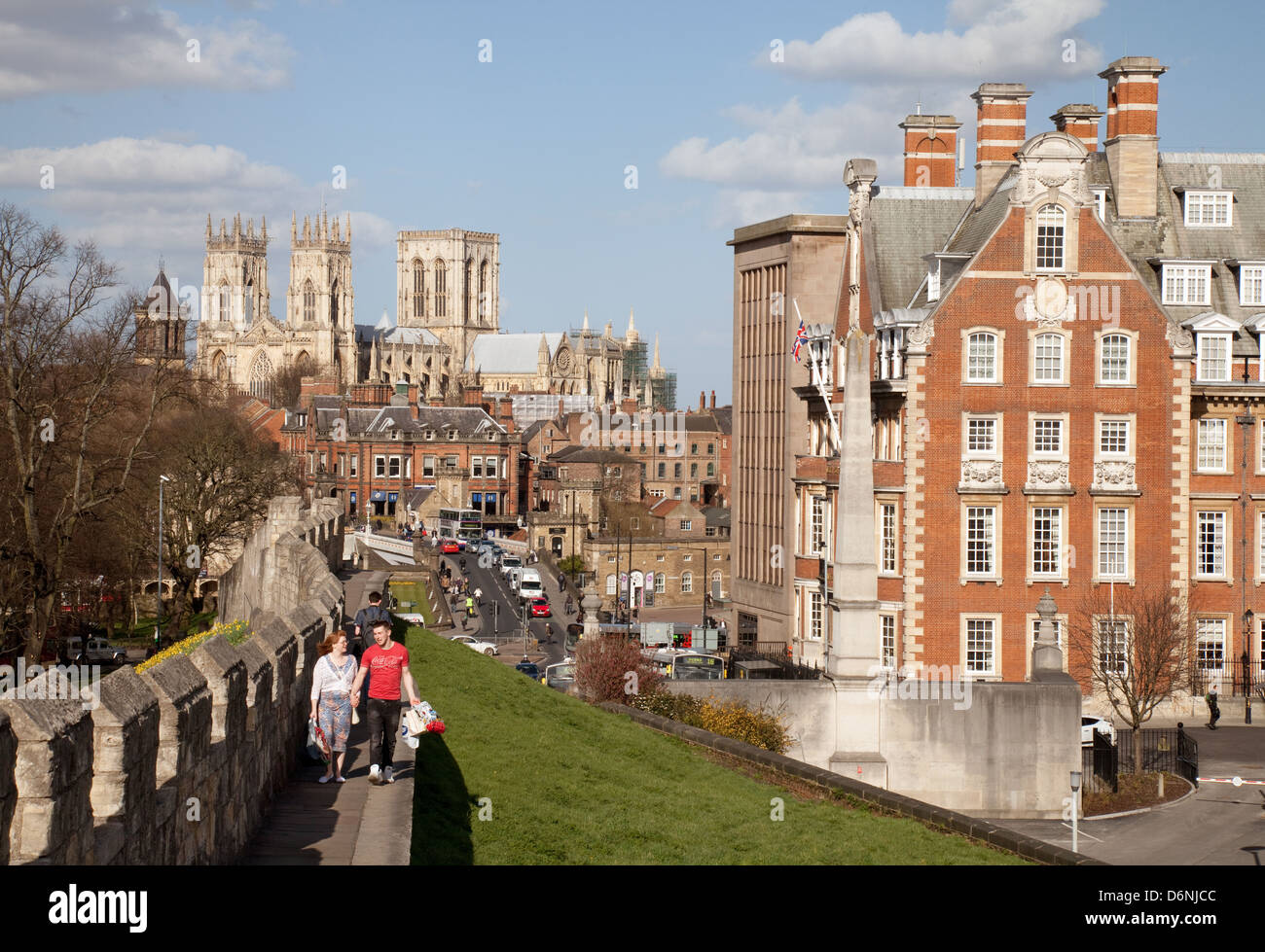 People walking on the old city walls, York, Yorkshire UK - Stock Image