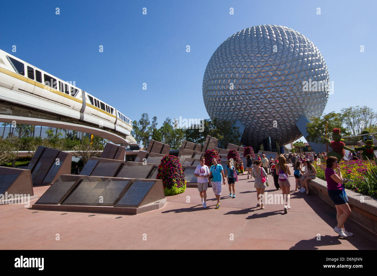 The Entrance to Epcot in Disney World resort, Florida, showing the Monorail and the iconic Spaceship Earth structure - Stock Image