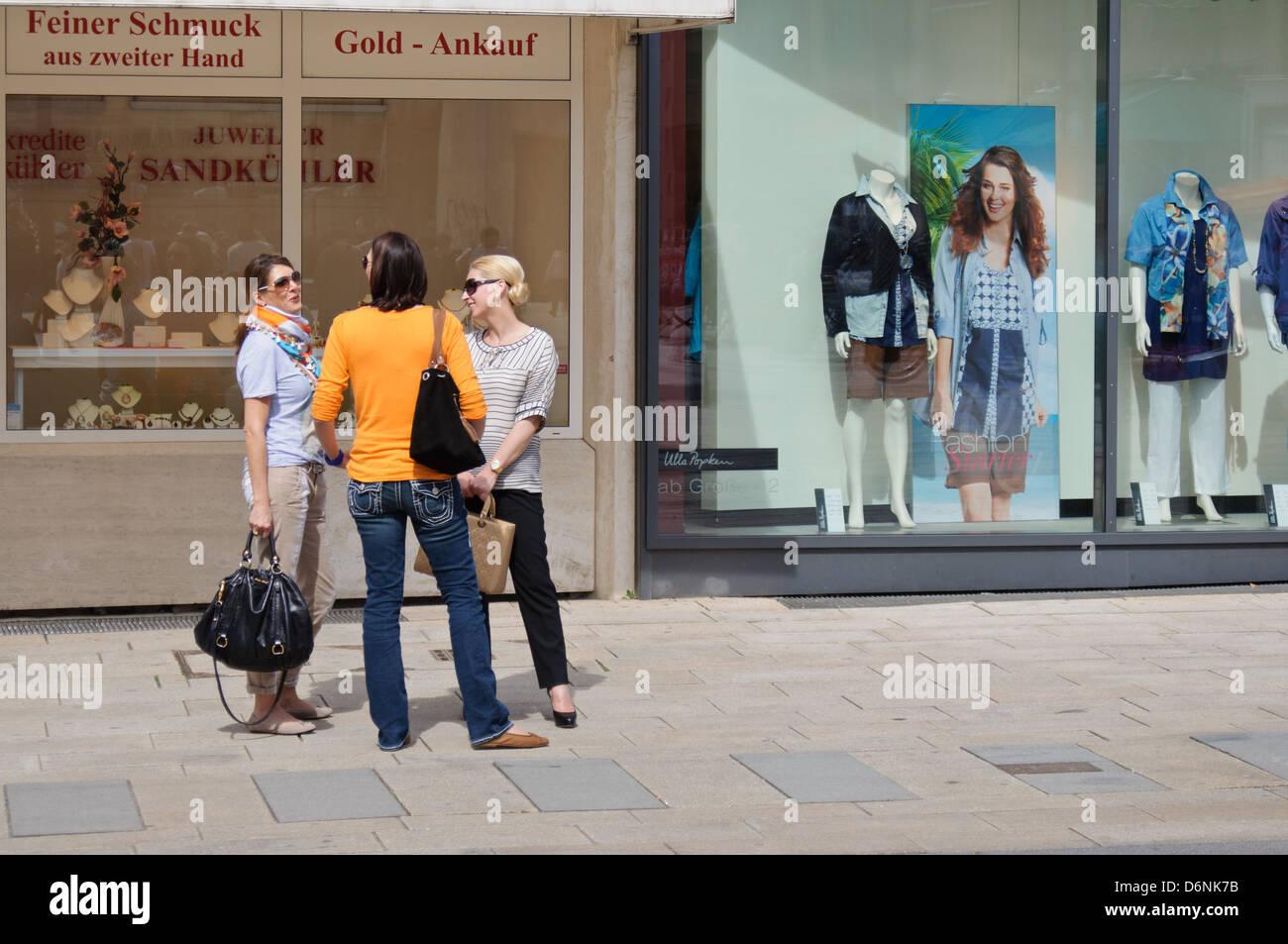 3 Caucasian German Women Gossiping Tattling In Front Of
