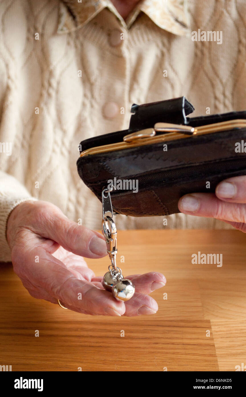 Elderly woman holds 'Jingle Bells' given by police to stop purse theft - Stock Image