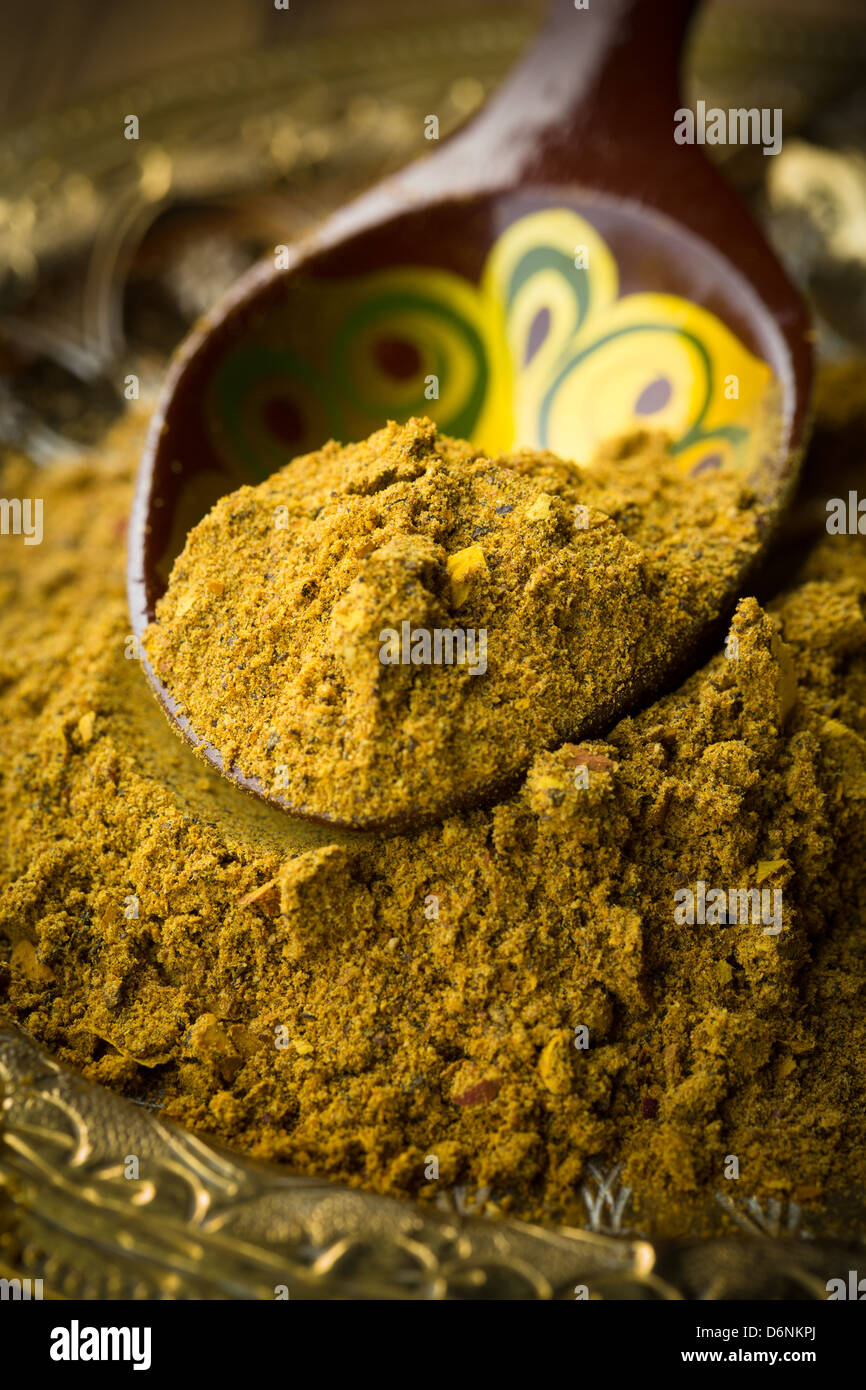 Curry powder on moroccan spoon - Stock Image