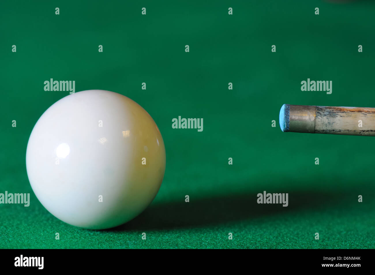 Close up of snooker ball and cue tip - Stock Image