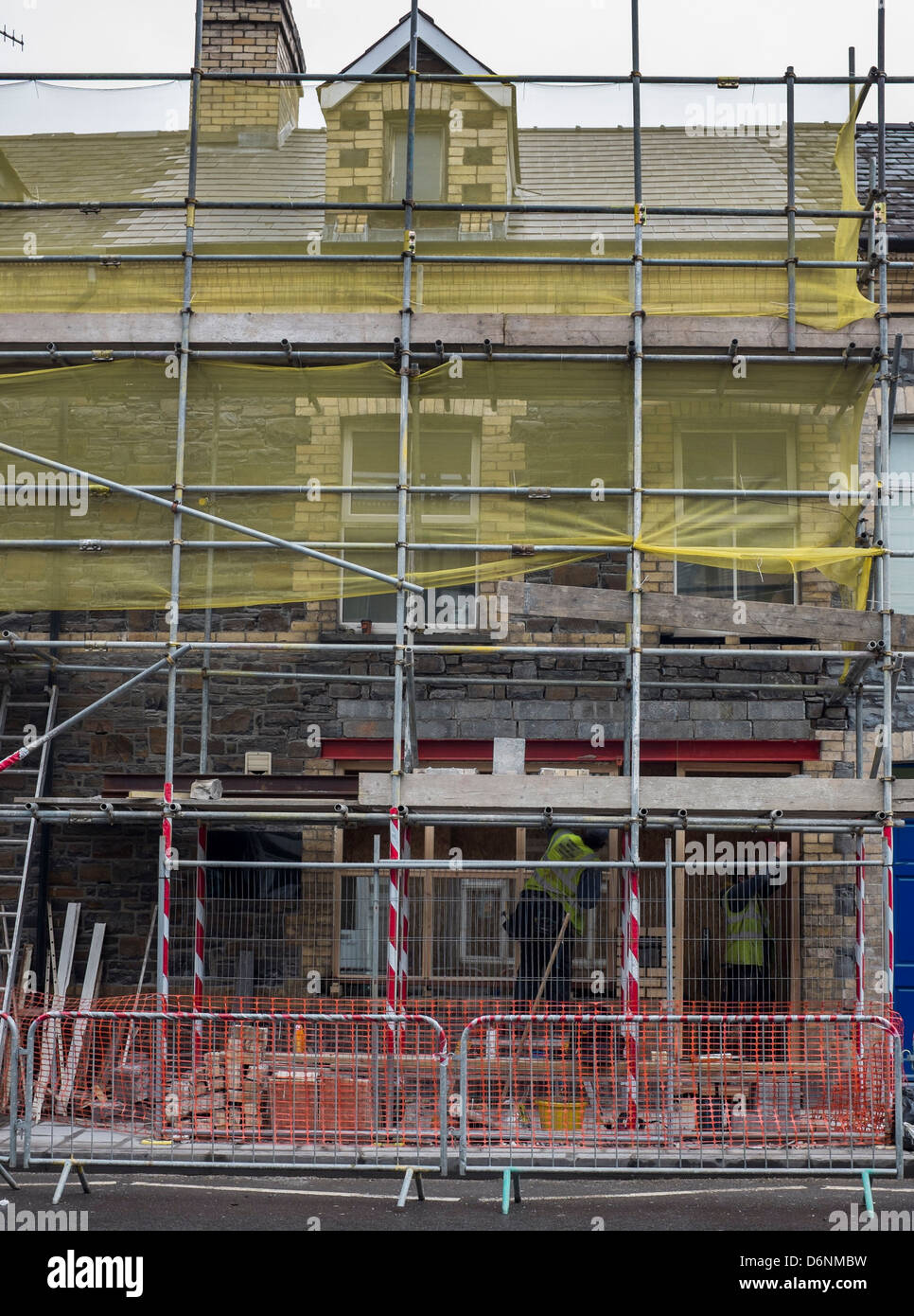 Scaffolding on a house being renovated as part of an urban renewal regeneration scheme Aberystwyth Wales UK - Stock Image