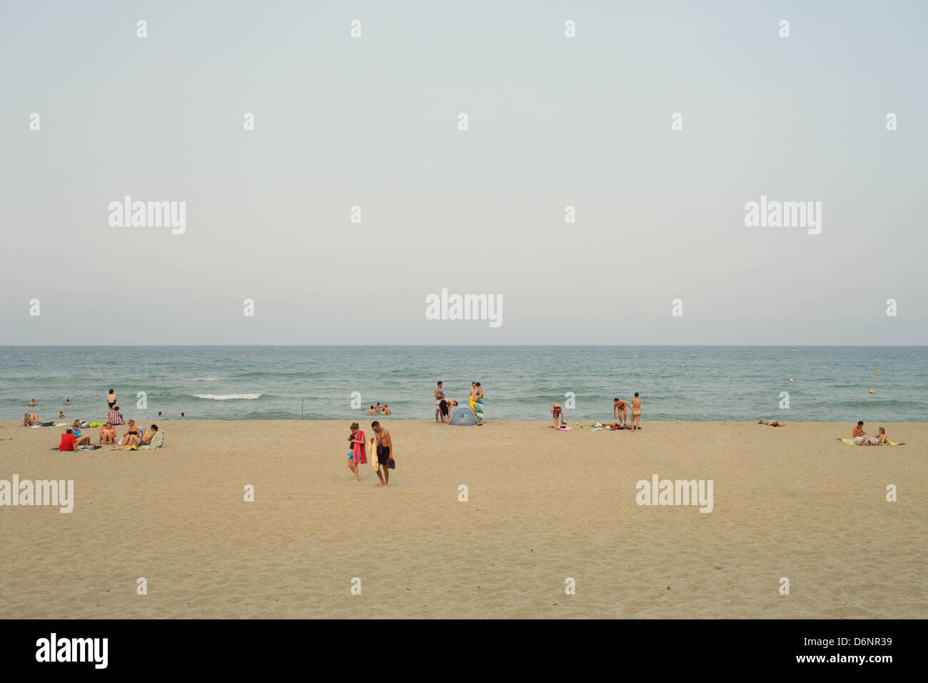 Le Barcares, France, bathers on the beach in the seaside resort of Le Barcares - Stock Image