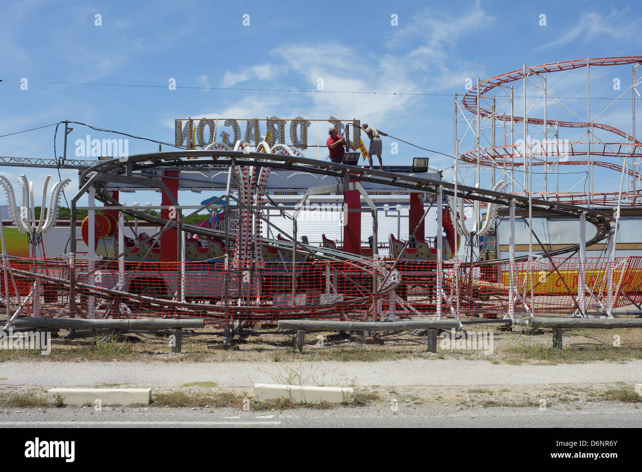 Le Barcares, France, men build a roller coaster at a fairground on - Stock Image