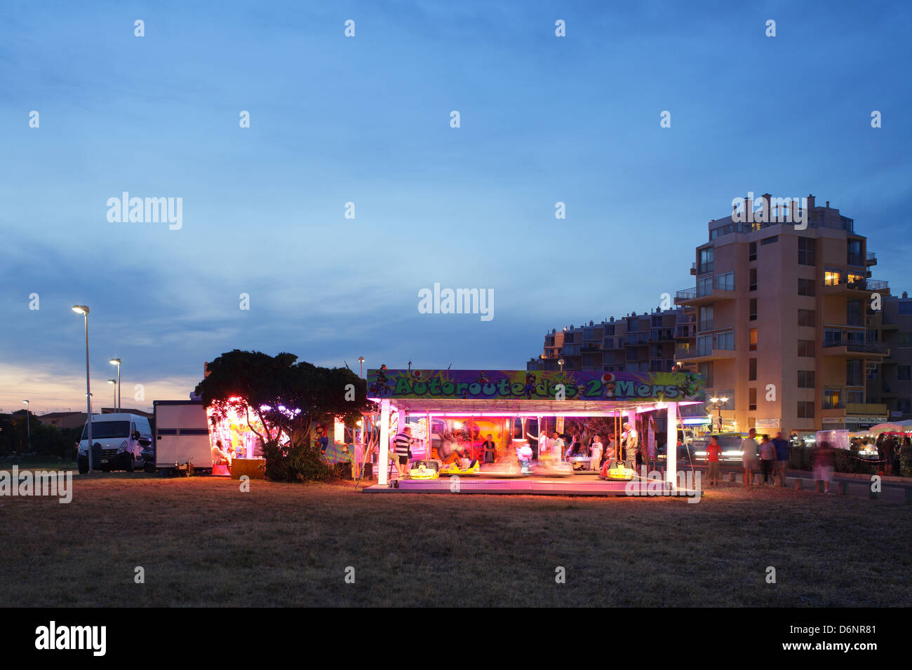 Le Barcares, France, carnival before apartment houses in a residential complex in the seaside resort of Le Barcares - Stock Image