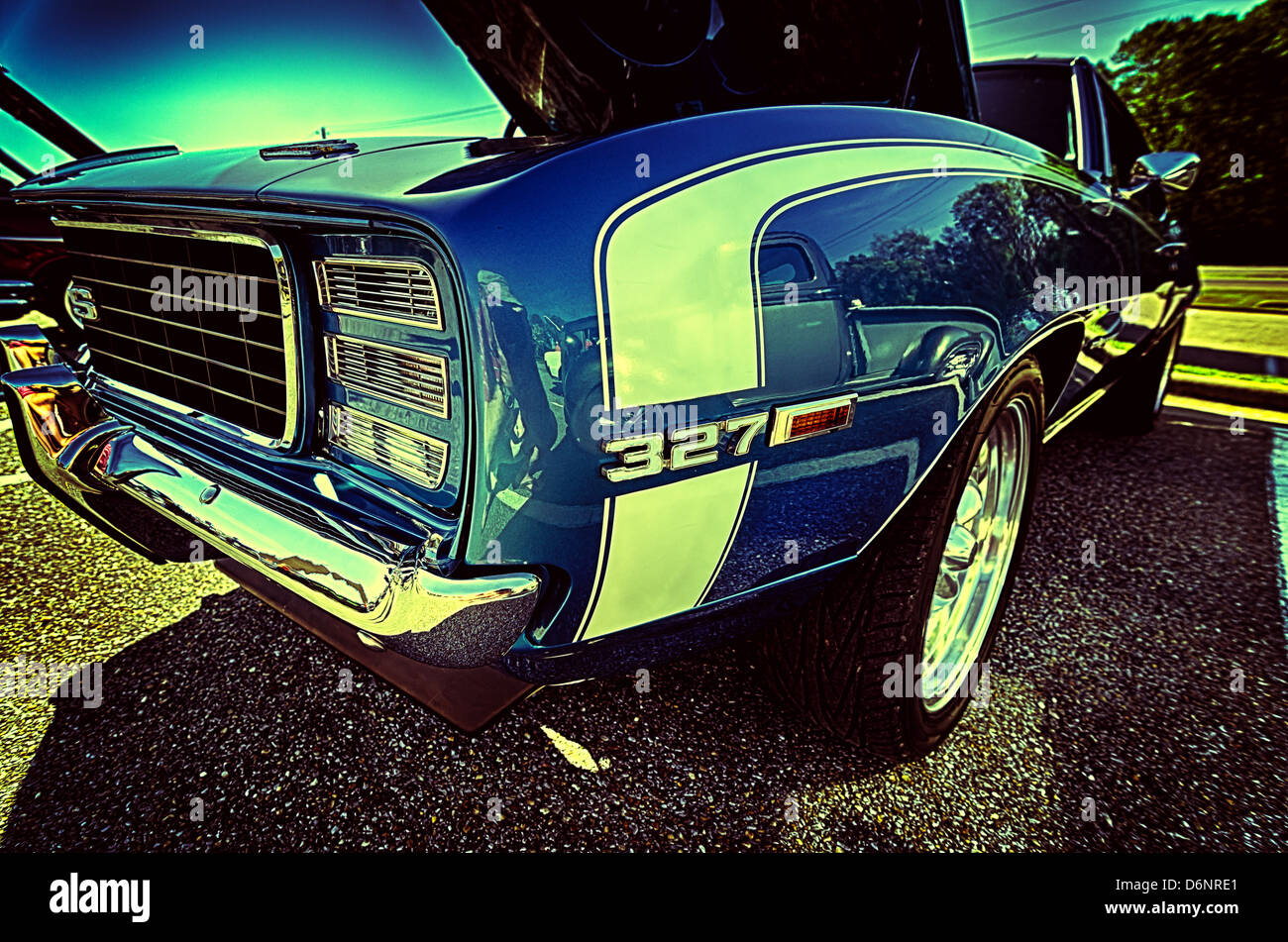 Closeup of blue vintage muscle car with 327 engine at car show Stock ...