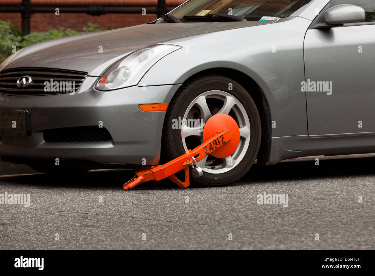 Car front wheel locked for violation - USA - Stock Image