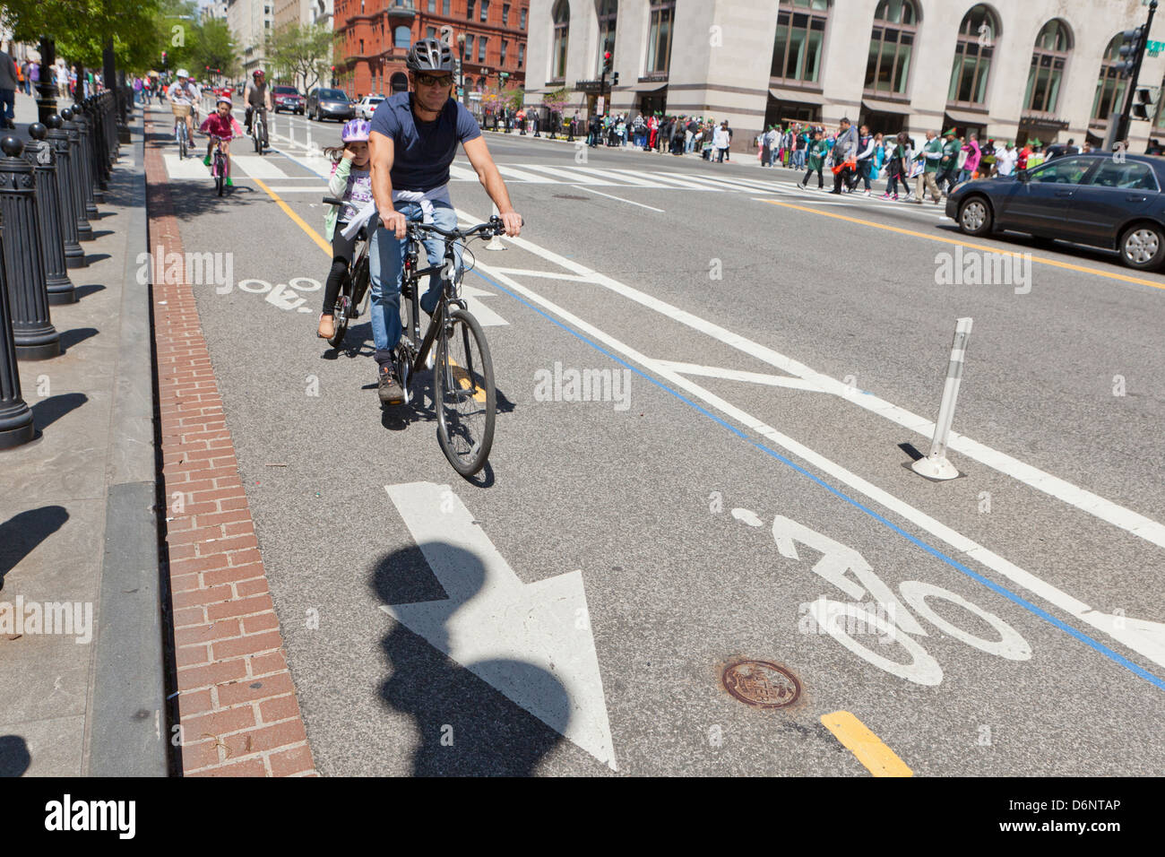 Cyclists riding in urban bike lane - Washington, DC USA - Stock Image