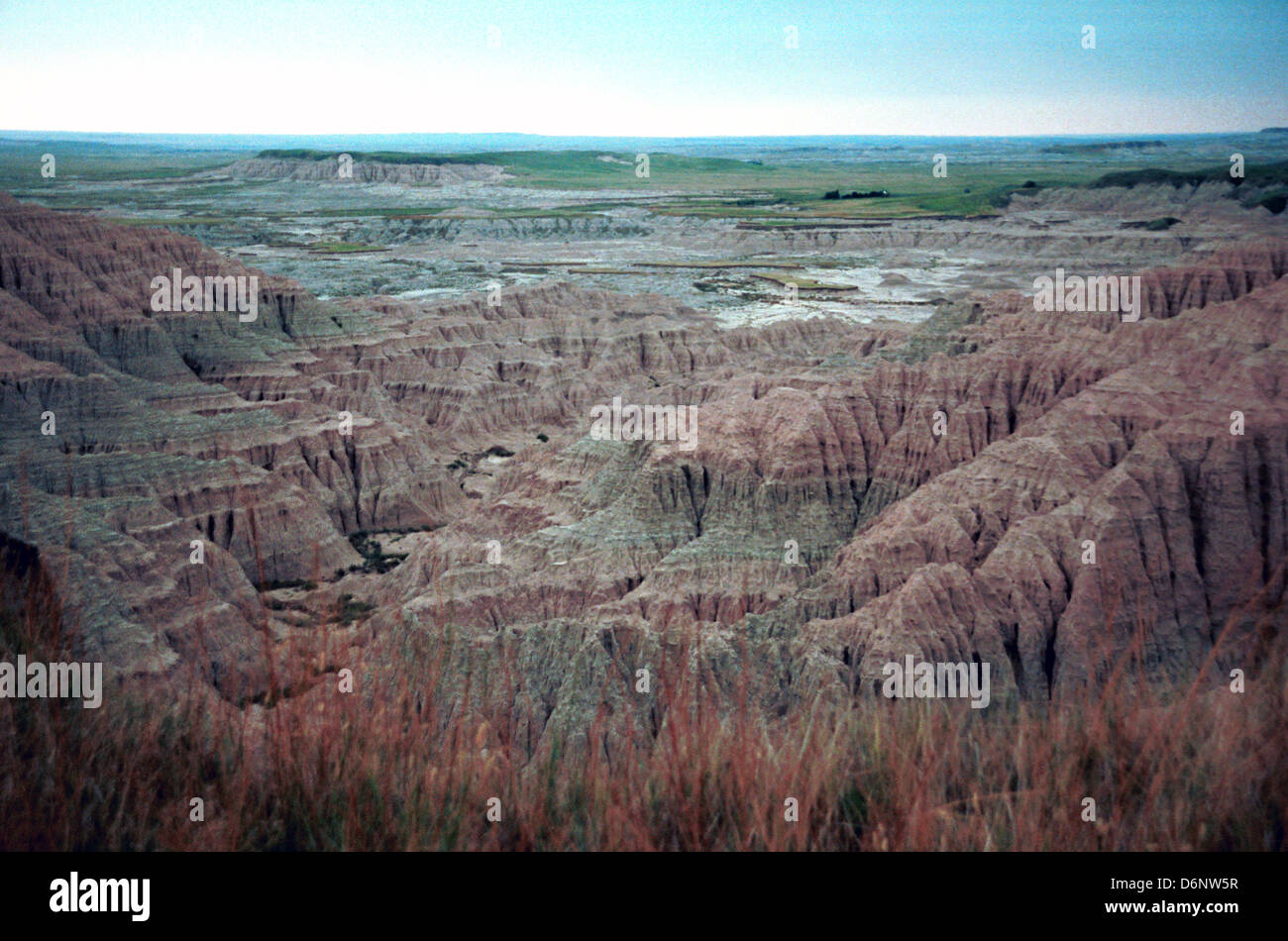 Badlands National Park southwest South Dakota of sharply eroded butts pinnacles and spires with mixed grass prairie Stock Photo