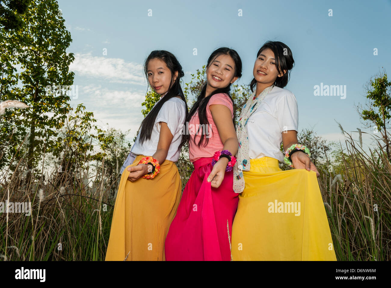Asian Thai girls are picking their skirts. - Stock Image