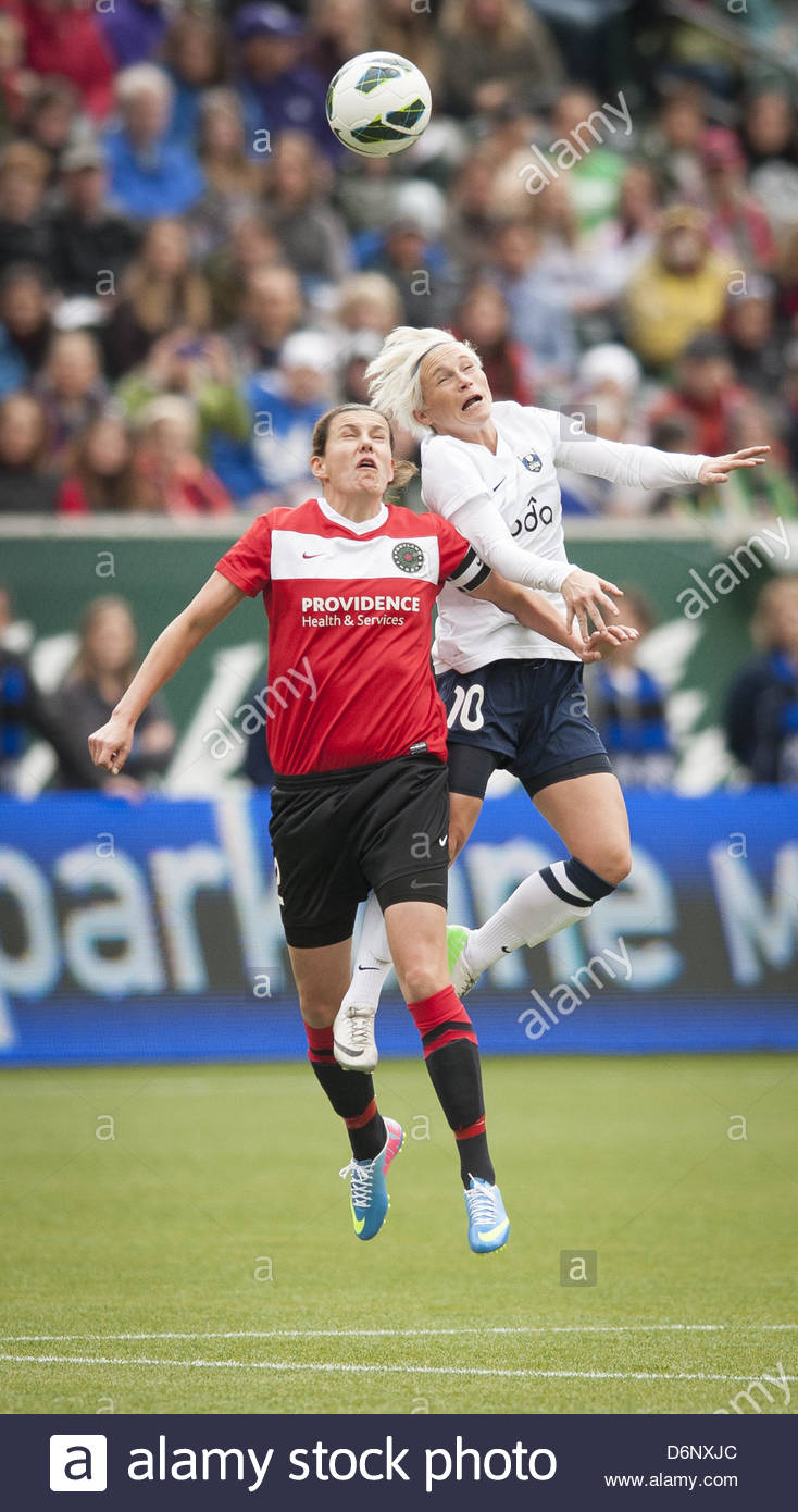 April 21, 2013 - Portland, OR, USA - Portland Thorns Christine Sinclair (12-red) airs it out against Seattle Reigns' - Stock Image