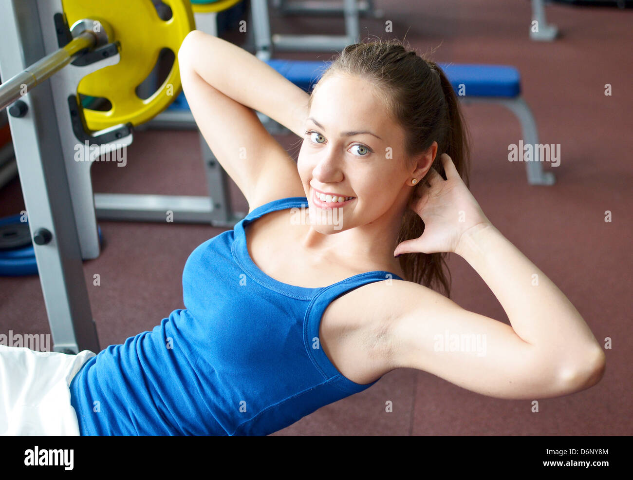 young pretty girl working out in a gym - Stock Image