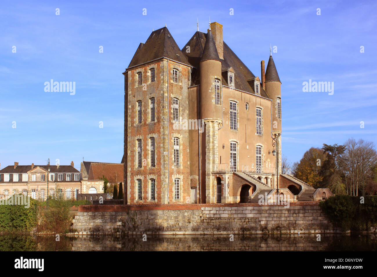 a castle with its moats, its park and garden with its towers and its ancient architecture - Stock Image