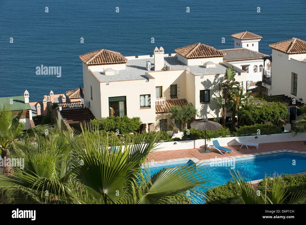 spanish villas overlook the mediterranean sea at la herradura stock