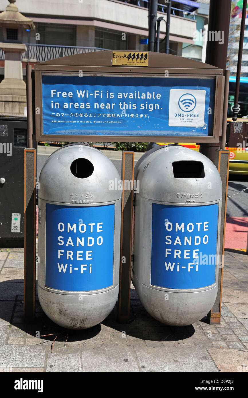 Rubbish bins advertising free WiFi in Harajuku, Tokyo, Japan - Stock Image