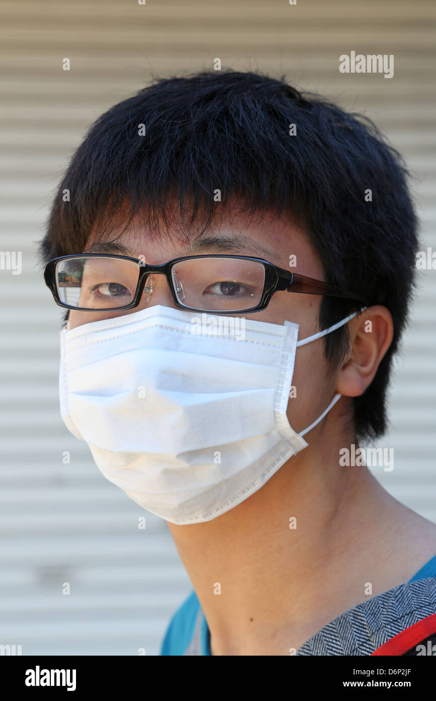 Japanese man wearing a protective face mask, Tokyo, Japan Stock Photo