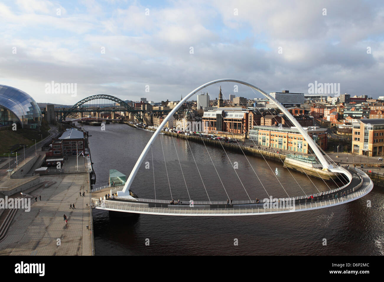 Millennium Bridge and Tyne Bridge span the River Tyne, from Gateshead to Newcastle, Tyne and Wear, England, UK - Stock Image