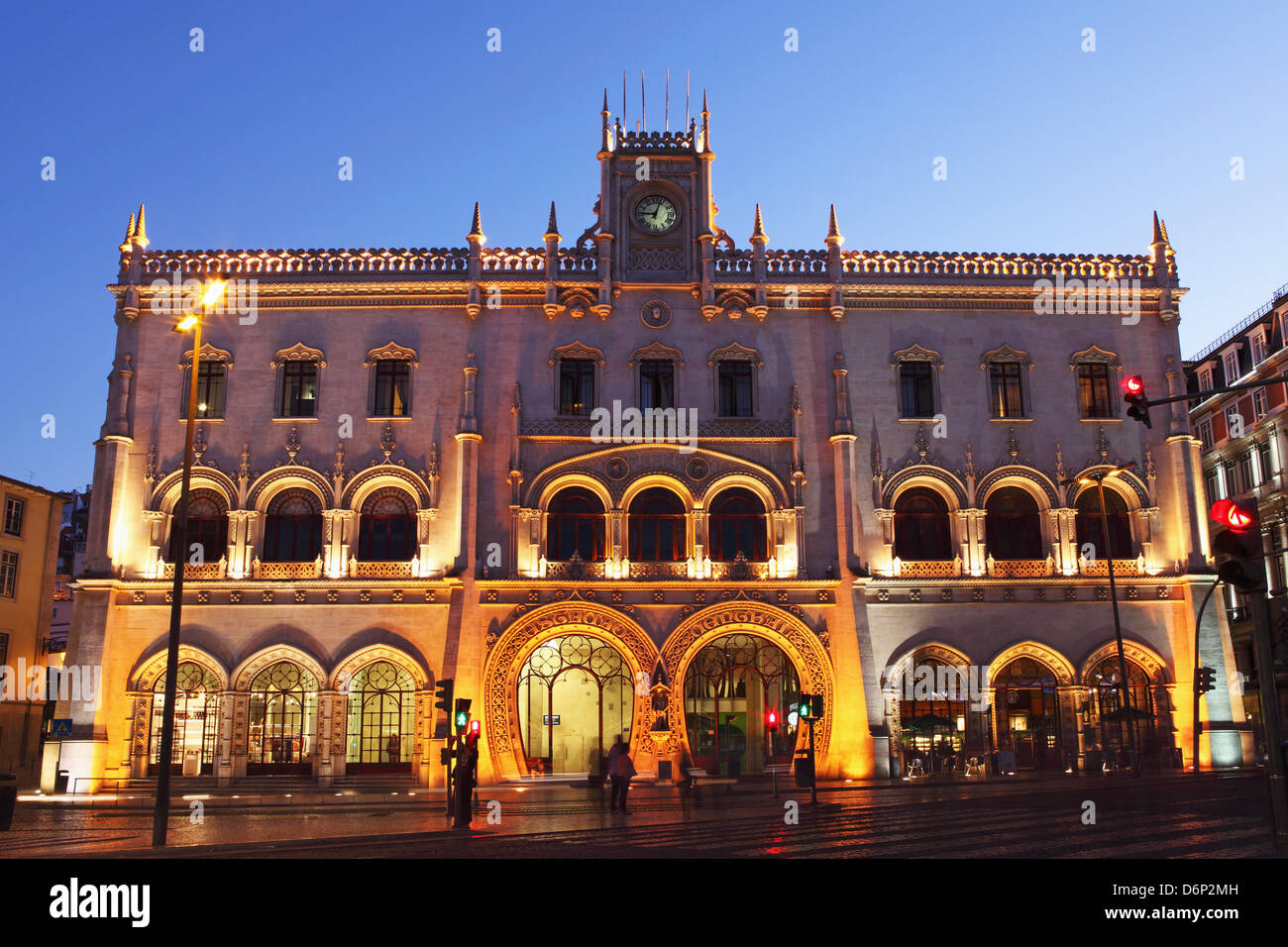 The Neo-Manueline facade of Rossio railway station, at night, in the Baixa district of Lisbon, Portugal, Europe - Stock Image