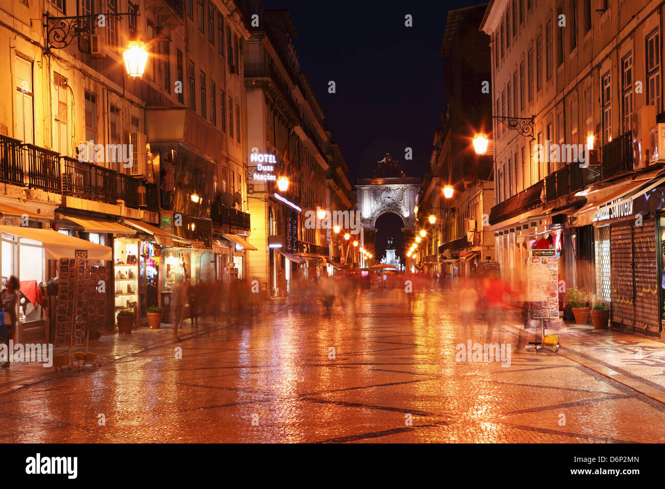 Warm summer's night on the cobbled Rua Augusta, leading to Arch of Rua Augusta, in the Baixa district of Lisbon, - Stock Image