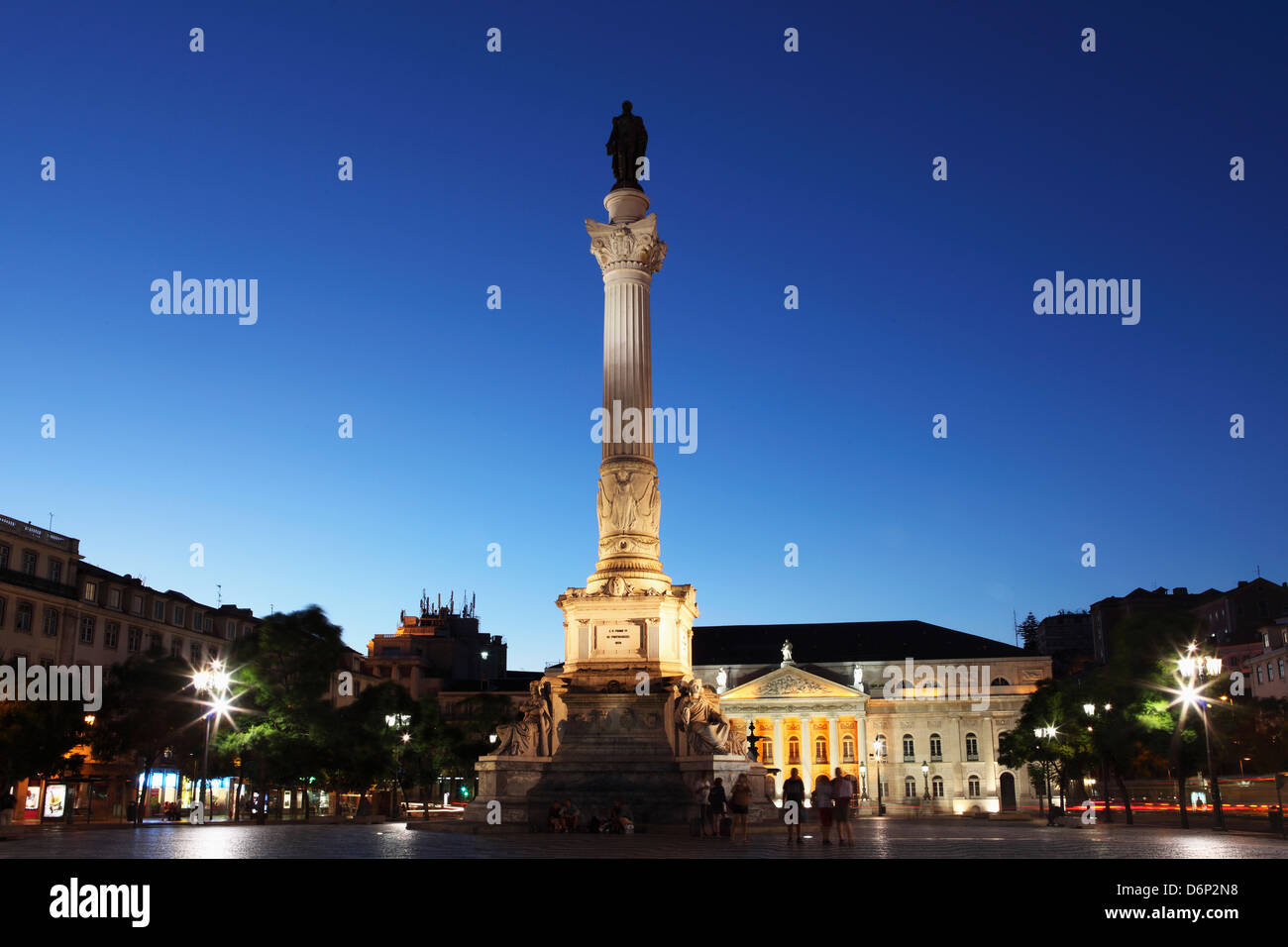 Statue of Portugal's King Dom Pedro IV, Dona Maria II national theatre at night, Rossio Square, Baixa district, - Stock Image