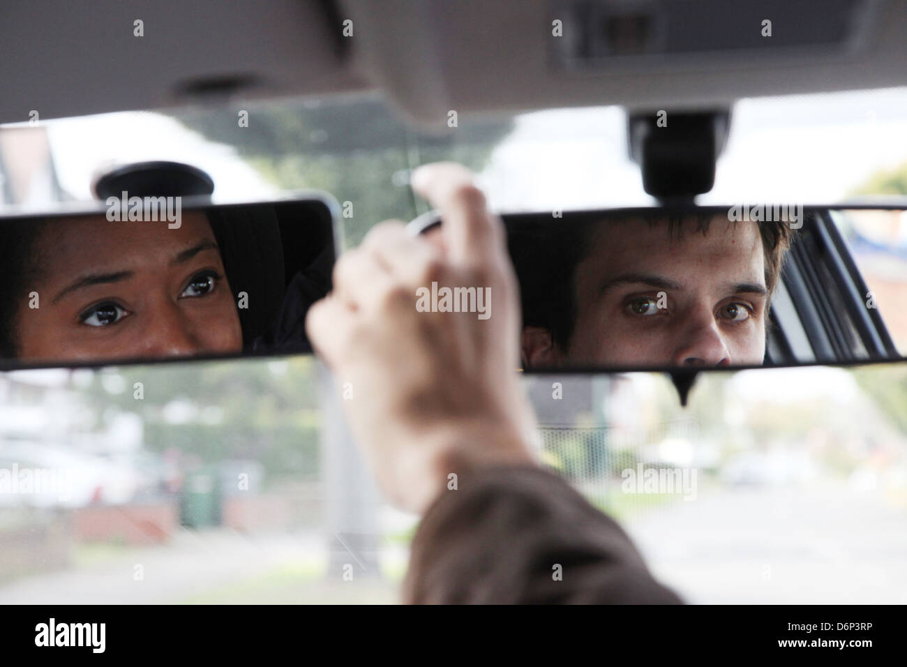 Mirrors showing a new driver and instructor in the mirrors - Stock Image