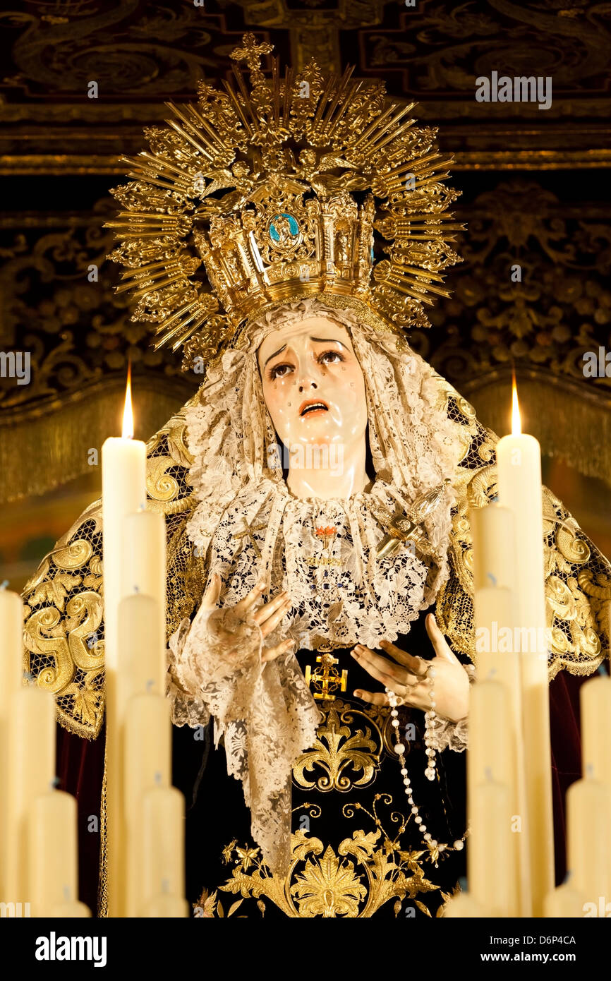 Image of Virgin Mary on float (pasos) carried during Semana Santa (Holy Week), Seville, Andalucia, Spain, Europe - Stock Image