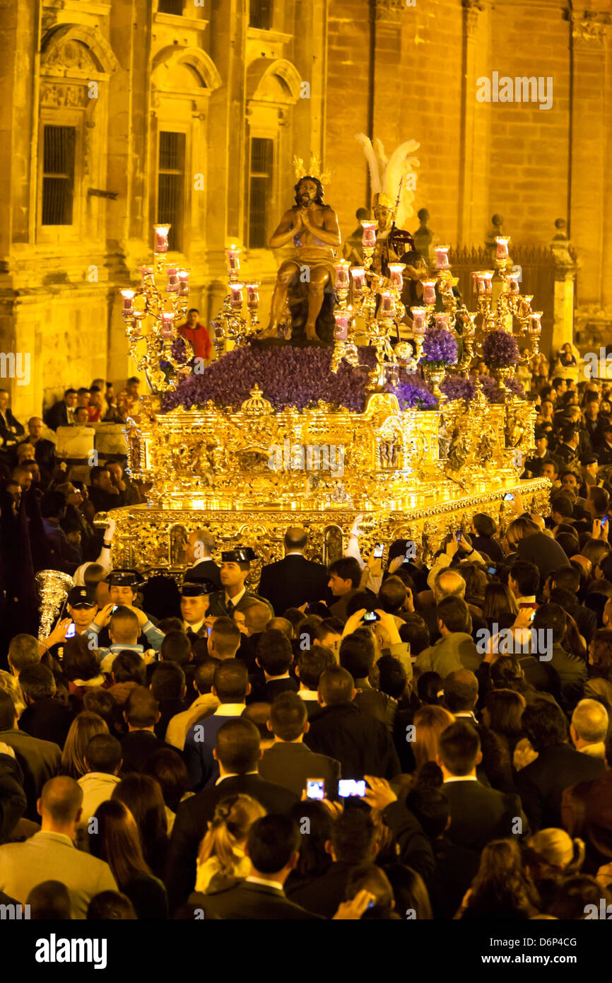 Semana Santa (Holy Week) float (pasos) with image of Christ outside the cathedral, Seville, Andalucia, Spain, Europe - Stock Image