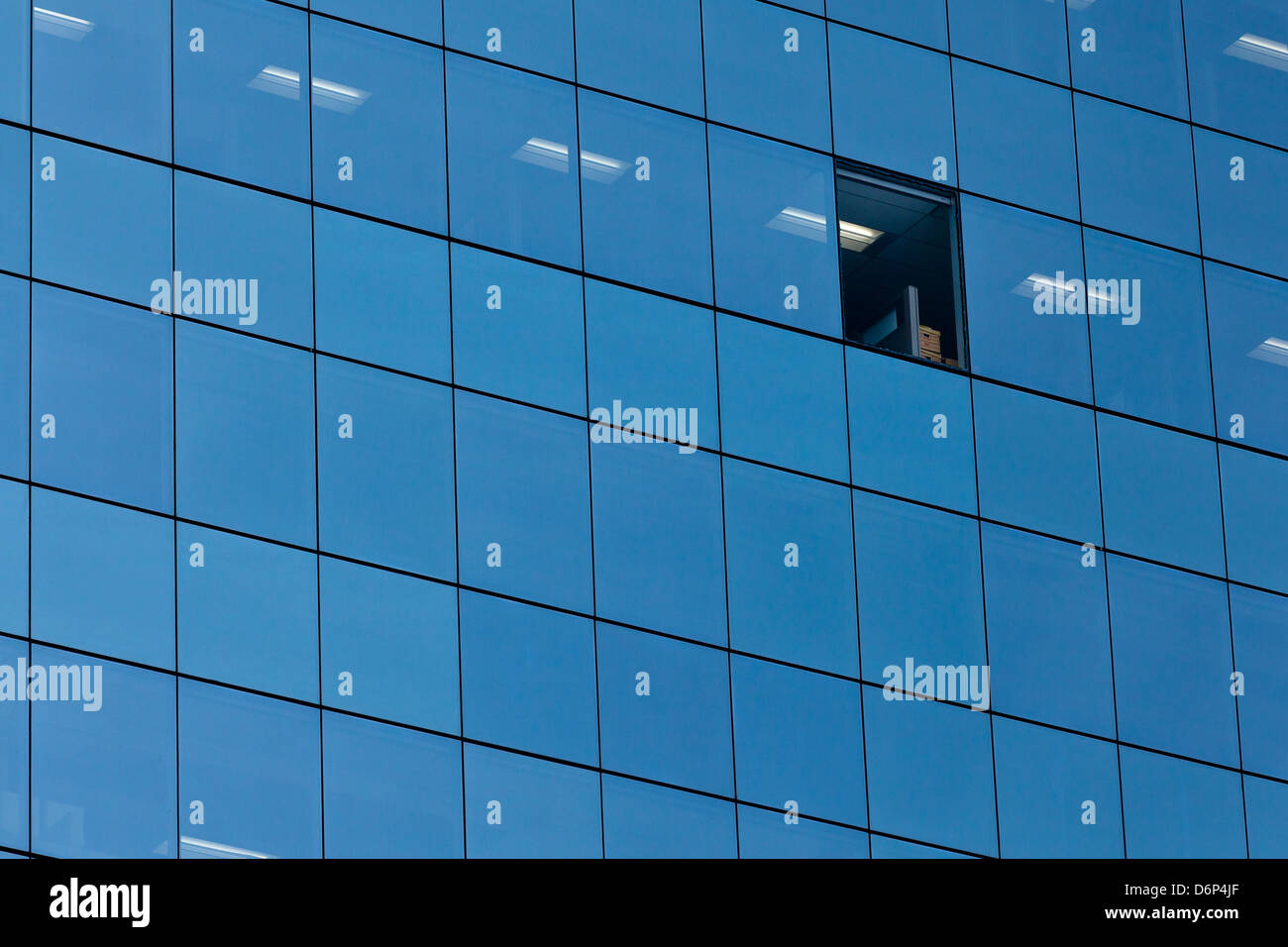 A Missing Glass Pane In A Glass Box Building Can Serve As A Symbol