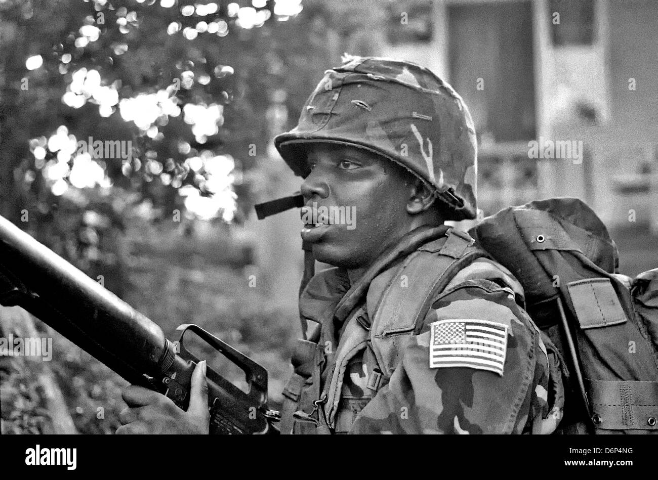 A US Marine armed with M16A1 rifle patrols the area around Grenville during the Invasion of Grenada, codenamed Operation - Stock Image