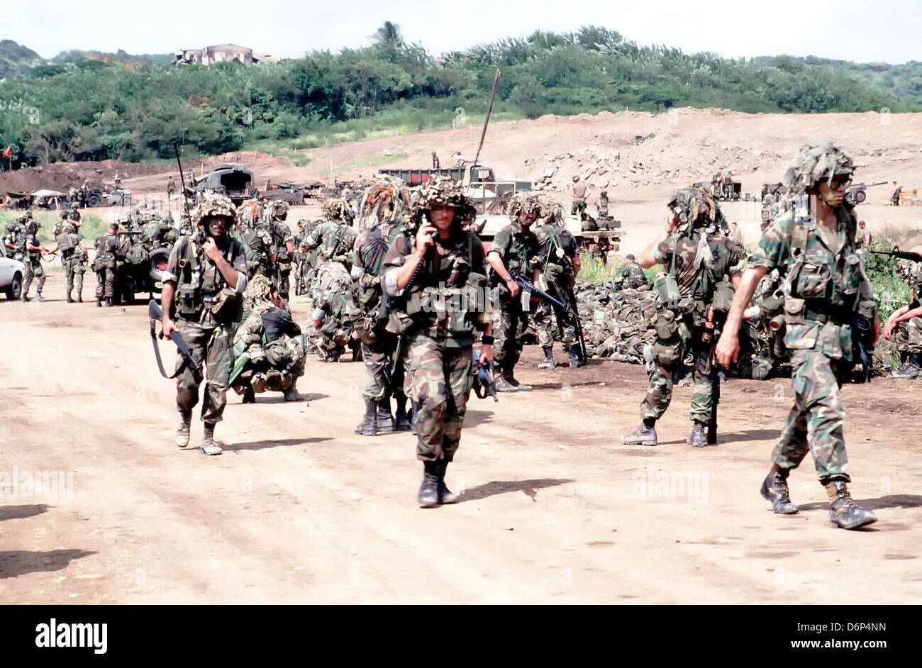 US 82nd Airborne Division soldiers walking during the Invasion of Grenada, codenamed Operation Urgent Fury November - Stock Image