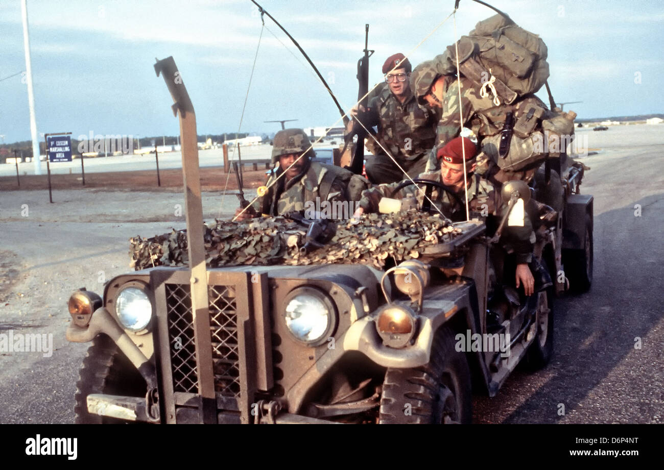 US 82nd Airborne Division soldiers wait in an equipment filled M151 light utility vehicle to be loaded for the Invasion - Stock Image