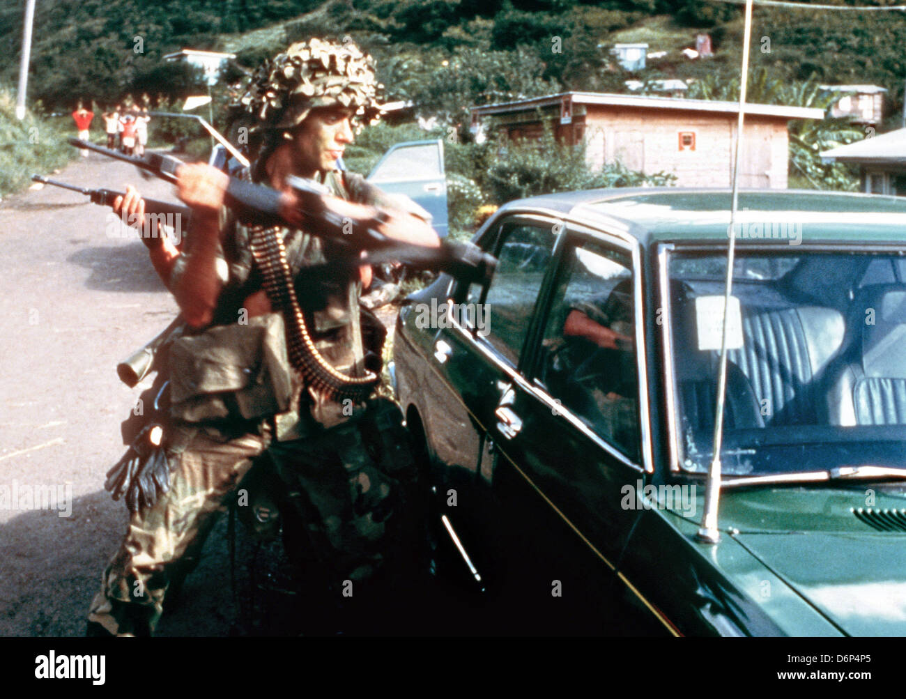 US 82nd Airborne Division soldiers use their rifle butts to break into a car to check for bombs during the Invasion - Stock Image