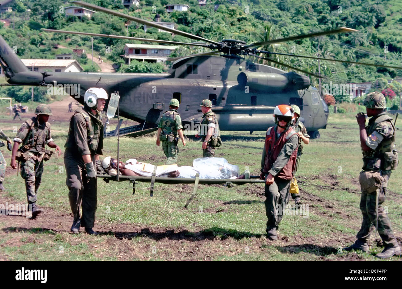 US Marines evacuate a wounded soldier to a waiting CH-53 Sea Stallion helicopter during the Invasion of Grenada, - Stock Image