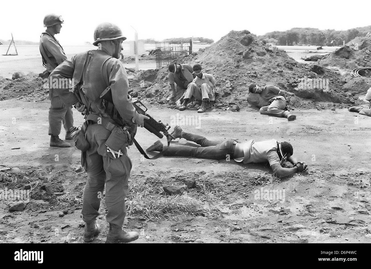 US Marines guard captured member of the Peoples Revolutionary Army during the Invasion of Grenada, codenamed Operation - Stock Image
